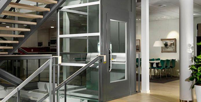 Enclosed platform lift used used inside multi-storey building