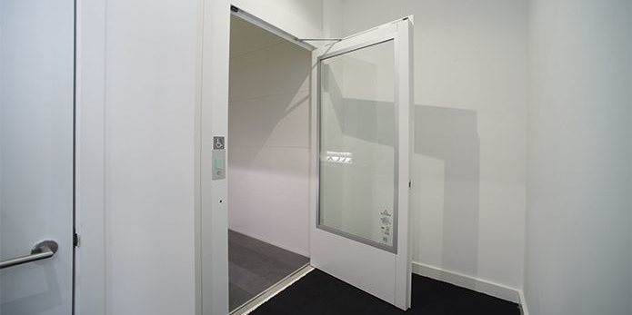 Internal platform lift with door open in South Avenue Studios