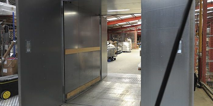 The Entertainer warehouse goods lift with back and front doors open
