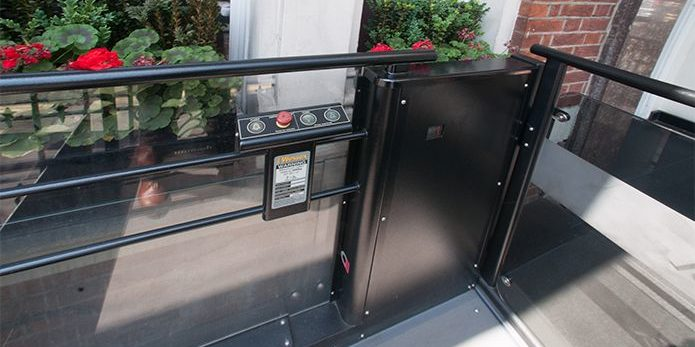 Low-rise platform lift with controls outside Doubletree by Hilton Hotel in Marble Arch