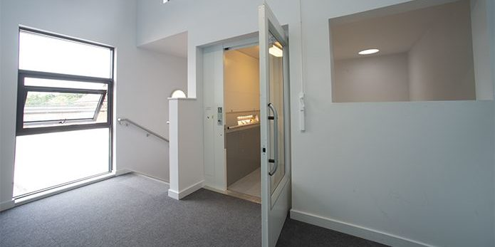 Passenger lift inside Hinchley Wood School with door open