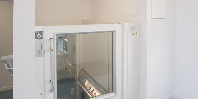 Half-floor platform step lift inside Hinchley Wood School