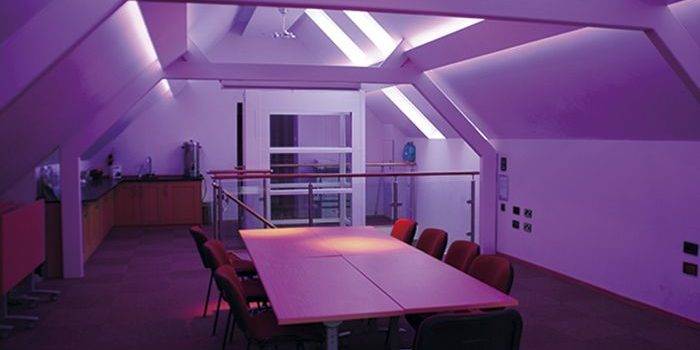 Kent Scouts meeting room with purple lighting showing the internal lift in the background