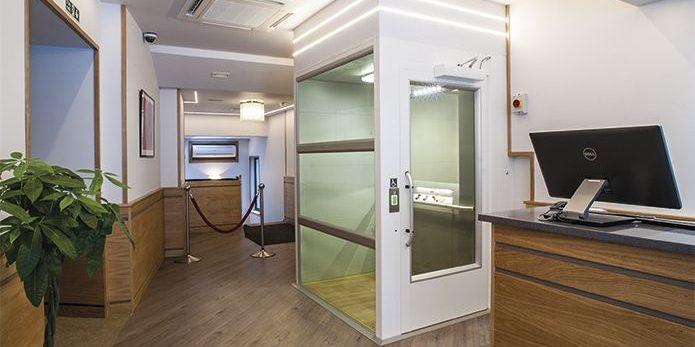 Exterior view of an internal platform lift inside London Kings Hotel