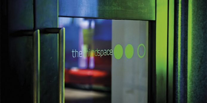 The Third Space logo on a glass door