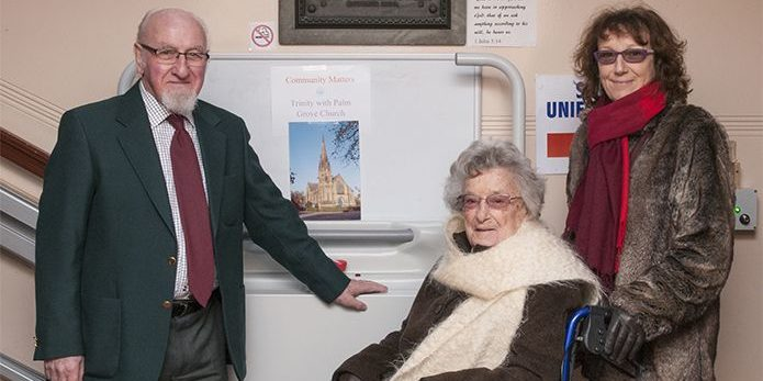 Visitors to Palm Grove United Reformed and Methodist Church standing next to an inclined platform lift