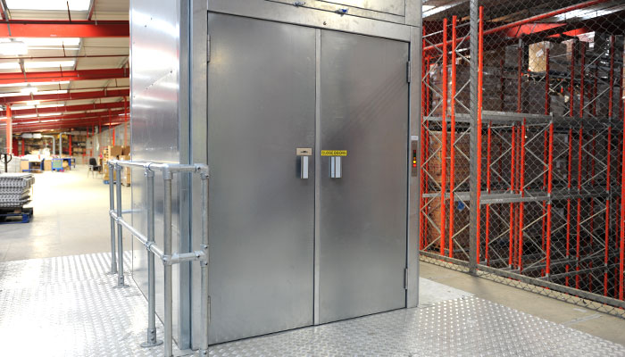 Attanded goods lift situated in warehouse environment