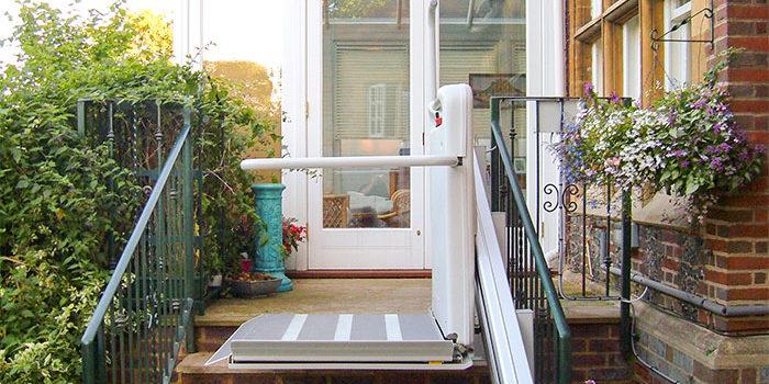 An inclined platform lift assiting travel down garden steps
