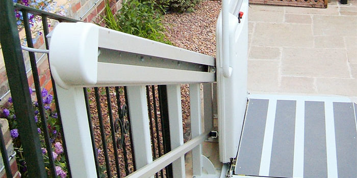Top-down views of an inclined platform lift used in a garden