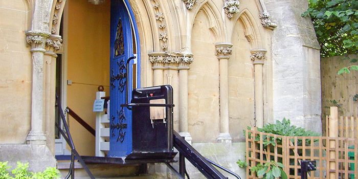 An inclined platform lift being used for steps outside a church