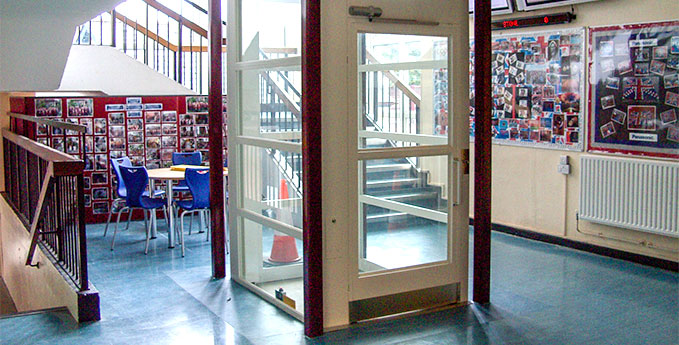 Vertical platform lift situated inside a school corridor