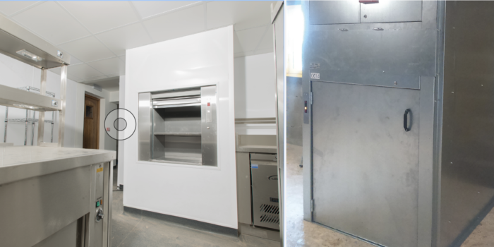 A dumbwaiter lift used in a commercial kitchen environment
